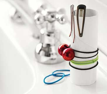 Stop searching high and low for hair clips and elastics: Store them tidily on an empty TP tube.