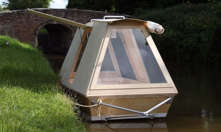 Sustainable living and transport- houseboat on wheels- a portable shelter for the water that you tow anywhere with your bike.