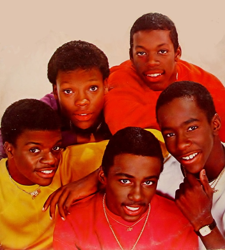 New Edition, R+B group. Originally comprised of Ronnie DeVoe, Bobby Brown, Ricky Bell, Michael Bivins, & Ralph Tresvant (& later Johnny Gill), the group reached popularity through the 1980s. They were the progenitors of the boy band movement, leading the way for groups like New Kids on the Block, Boyz II Men, Jodeci, Backstreet Boys and 'N Sync. Their older & newer hits include Candy Girl, Cool It Now, Mr. Telephone Man, If It Isn't Love, Can You Stand the Rain, Hit Me Off, Hot 2Nite…