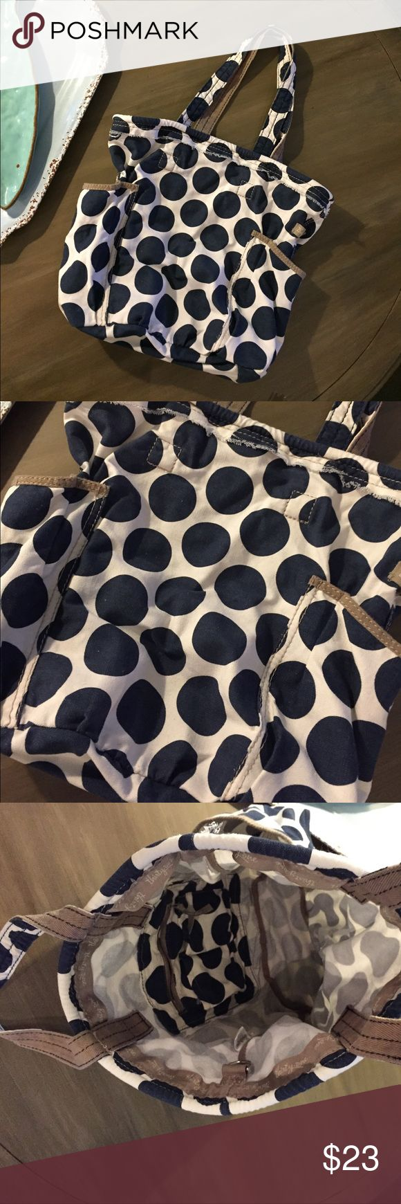 """Thirty-One Gifts Navy Mod Dot Metro Retro Tote Slouchy tote from Thirty-One Gifts. The metro retro is a big open tote with two exterior side pockets for easy access to water, sunglasses, phone/keys etc. Inside is a large open compartment with a side pocket that has a zip enclosure & 2 pockets for phone/glasses. 17"""" wide x 14"""" tall, shoulder drop 9"""". Very gently used with only a few small marks near bottom - see picture where I'm pointing - pretty minor. Thirty-One Gifts Bags Totes"""