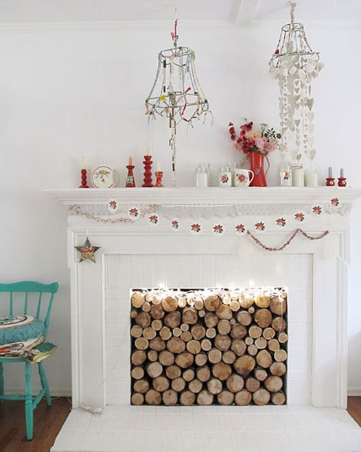 mobiles above the fireplace (found via sfgirlbybay)