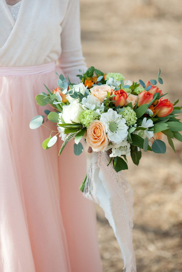 Peach and white spring bridal bouquet of double tulips, scabiosa, viburnum, ornithogalum, veronica, roses and mixed foliage.  Calgary Wedding Flowers www.flowersbyjanie.com  Photo: @tarawhitphoto
