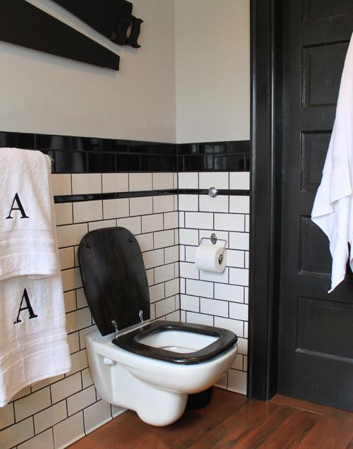 Wall mounted tankless toilet, with black lid & seat. Dark grout & subway tile. This is an alternate view of one of my other pins. Love the black trim!