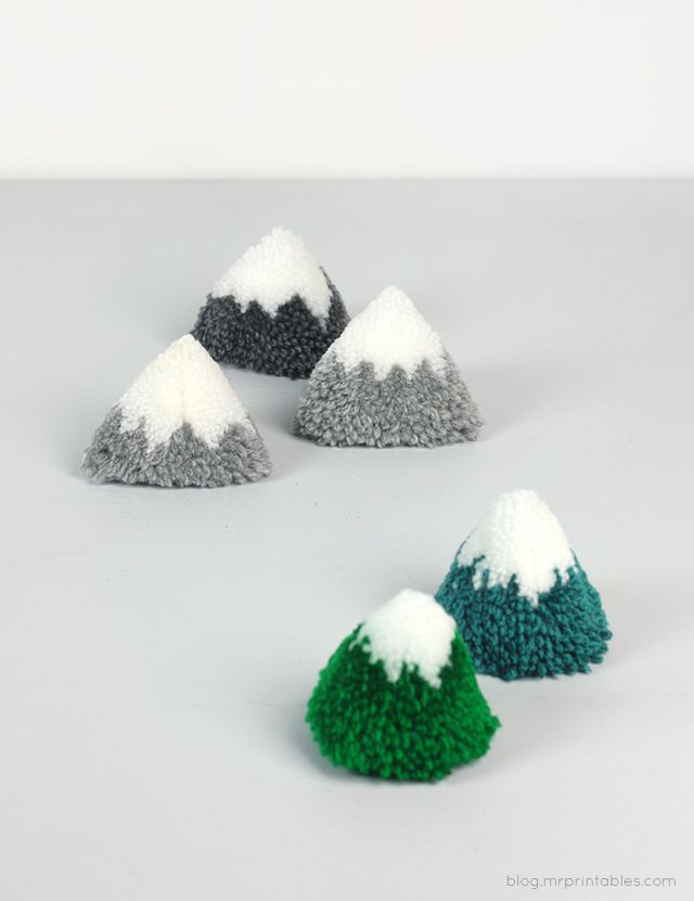 DIY Pompom Mountains Tutorial - somehow I think I would enjoy this more than a kid, but the pic is just so cute.