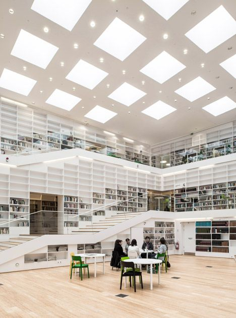 Dalarna Media Library by Adept This is great because it looks nice like this, and I can imagine it would look just as nice if these shelves were entirely filled with books. Great forward thinking design.