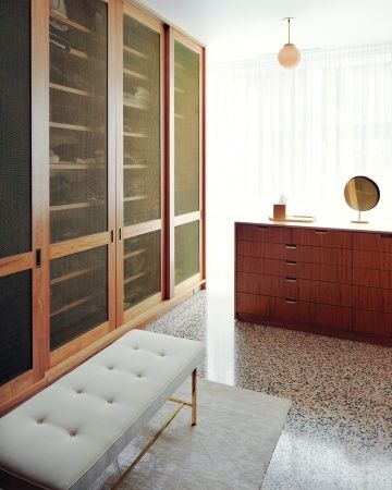 Alexis Stewart closet:   The closets were carefully designed: The wood was chosen to match the furniture, and the doors were made with screens (a suggestion from Martha) for ventilation.