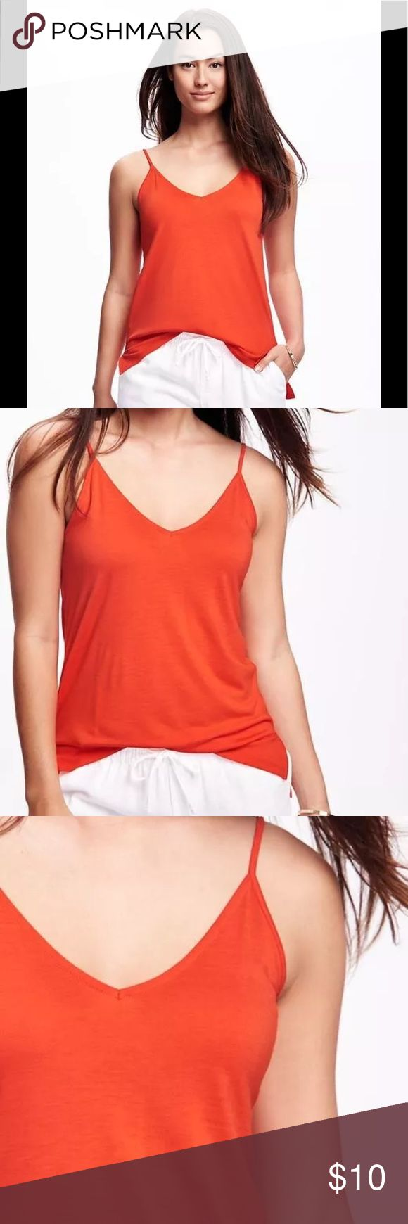 Old Navy Strappy blouse Orange Sz M New Old Navy Strappy blouse Sz M New  Fabric & Care:  100% Rayon. Machine wash cold gentle cycle, wash and dry with like colors. Imported Made in Haiti. Product Details: V-neck; spaghetti straps. Spaghetti straps. Smooth, medium-weight & side slits.  Simple and casual, wear by itself or with a pullover. Old Navy Tops Tank Tops