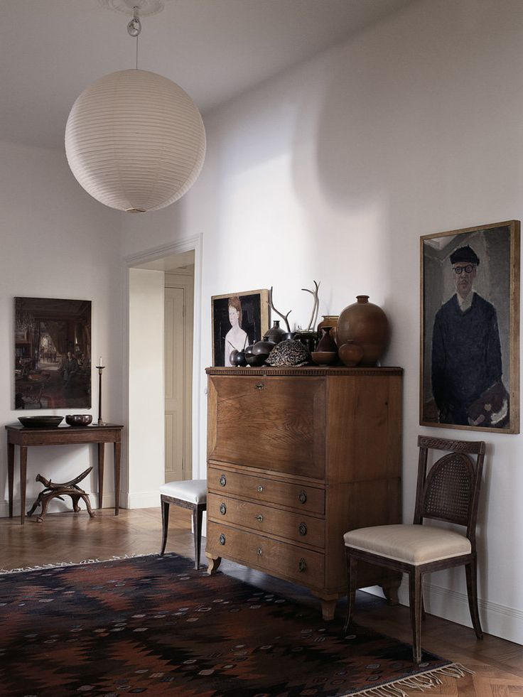 The foyer also combines 19th-century furniture with a light by Isamu Noguchi (Photo: Magnus Marding)