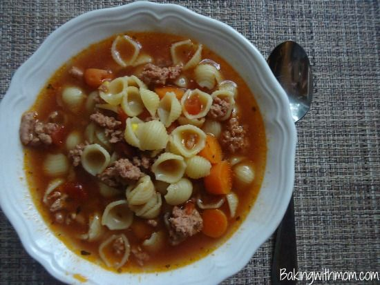 hamburger soup with tomatoes, pasta, carrots- a meal made in the crock pot for those busy family nights.