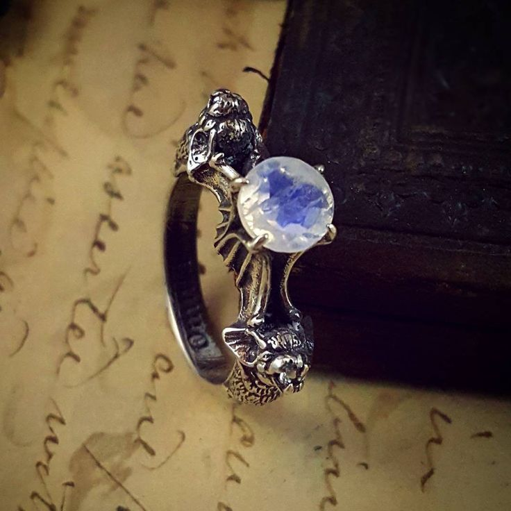 """Ready to ship sterling silver Nocturne ring with rainbow moonstone and white topaz size 7.5, use code """"BIRTHDAY"""" for 15% off! (Located in the premade category ♡)"""
