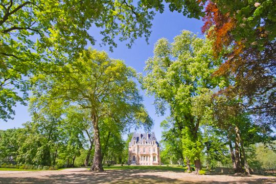 About 32 kilometers northwest of Paris, along the Oise River, lies the small town of L'Isle Adam, an idyllic spot to spend a Sunday afternoon. http://parisweekender.com/2012/05/an-afternoon-in-lisle-adam/