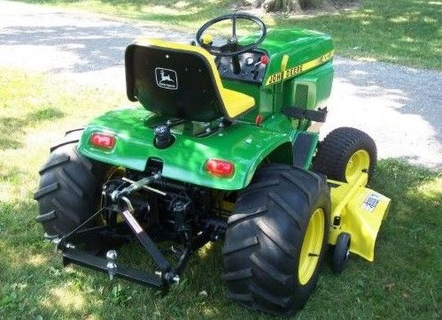 1981 John Deere 400 garden tractor and riding lawnmower Mows, pushes snow w blade, tows with 3