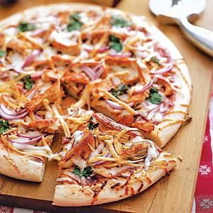 Lose the bun and move shredded barbecue chicken onto a pizza crust for a tasty fusion of Italian and Tex-Mex flavors.