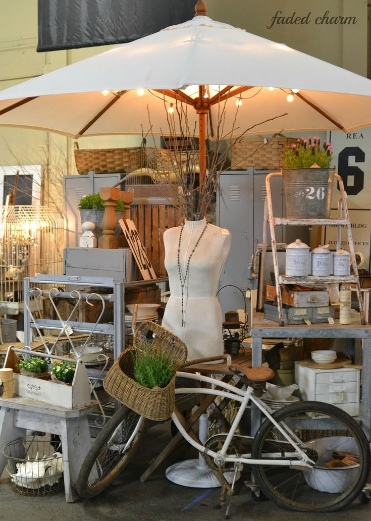 Vintage Flea Market Stall ideas- A large umbrella with fairy lights to cover display From Faded Charm