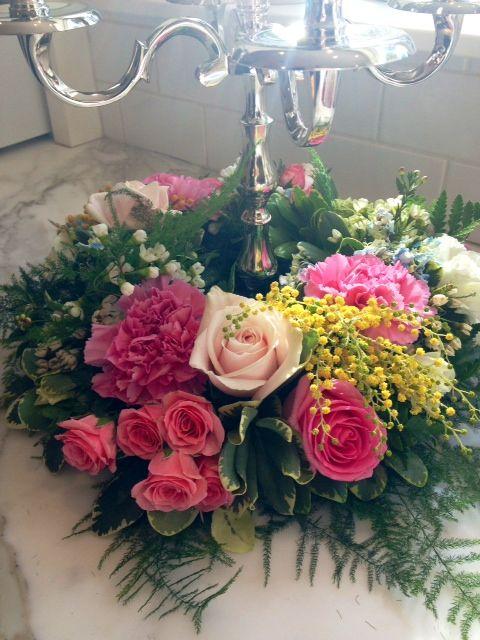 Floral wreaths for candelabras made by Phoenix Flower Shops, 5012 E Thomas Rd Phoenix, AZ 85018 6028401200