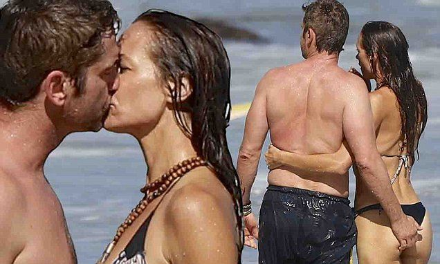Gerard Butler is VERY hands on with girlfriend on the beach in Malibu