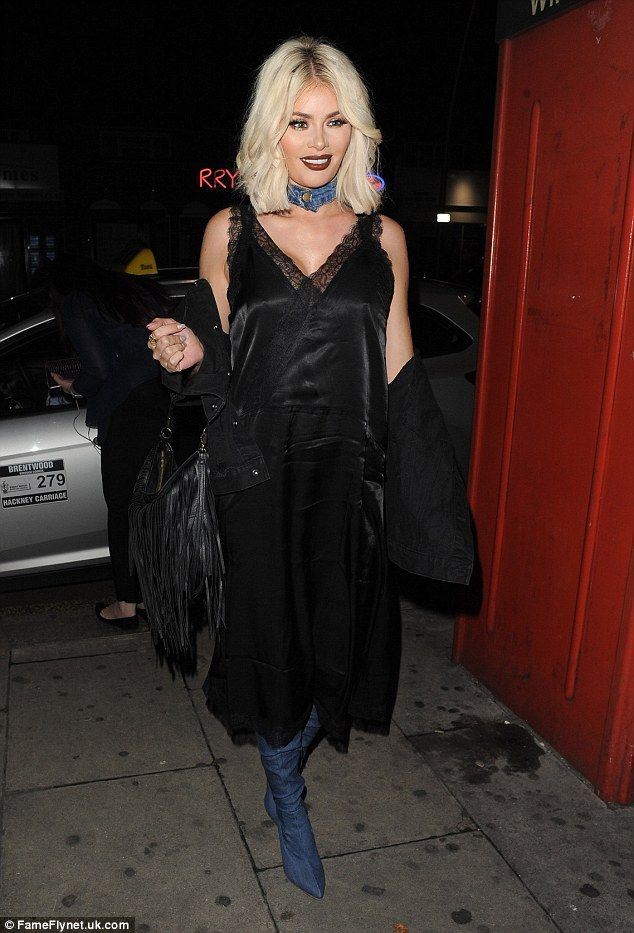 Gothic girl: Chloe Sims, 33, turned heads in a quirky Gothic-style black slip dress and denim choker combo, as she ventured to Faces nightclub on Monday to film for TOWIE