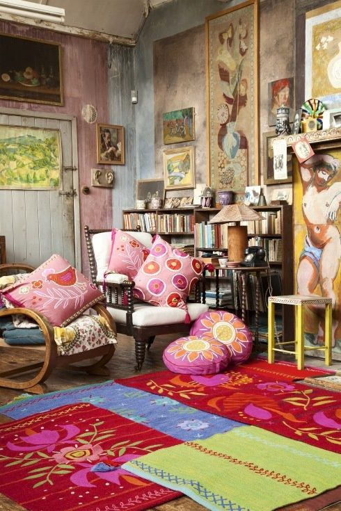 shabby muted tonal walls, set of with eclectic art and pop colours in layered rugs and funky pillows