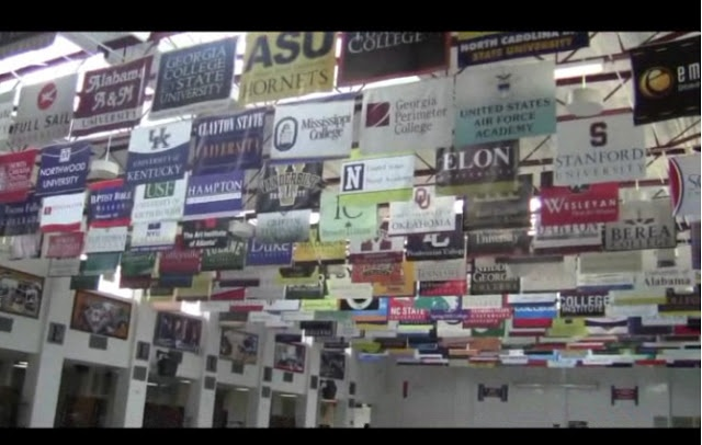College banners hanging from high school cafeteria