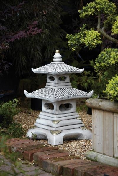 This Two Tiger Pagoda Garden Ornament is an icon of eastern culture the style began to emerge centuries ago spreading throughout East Asia.  This would be a perfect piece for your garden, the details are impossible to miss making people stop and star at its beauty for more information about this go to   http://www.gardensite.co.uk/Borderstone_Two_Tier_Pagoda_Garden_Ornament.htm