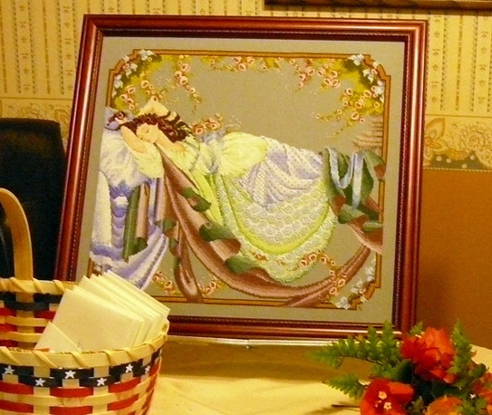 Sleeping Beauty cross-stitched picture.  There are hundreds of beads on this piece also.
