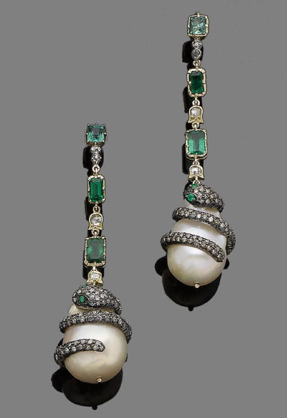 A pair of emerald, cultured pearl and diamond pendent earrings  Each baroque cultured pearl drop, encircled by a single-cut diamond snake, highlighted with circular-cut emerald eyes, suspended from a row of collet-set rectangular-cut emeralds, alternating with single and rose-cut diamonds, diamonds approx. 1.20cts total, length 6.7cm. Victorian or Victorian style.