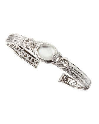 Sterling silver. Clear crystal over mother of pearl at center. Carved links flank center. Textured bangle with open base. Hinge side for slip-on ease. 6 1/2inH x 1/4inW. Imported. More Details