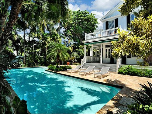 A narrower pool like this could run around the house and then have the dining platform in the middle. The house would be more of a Southwest look.