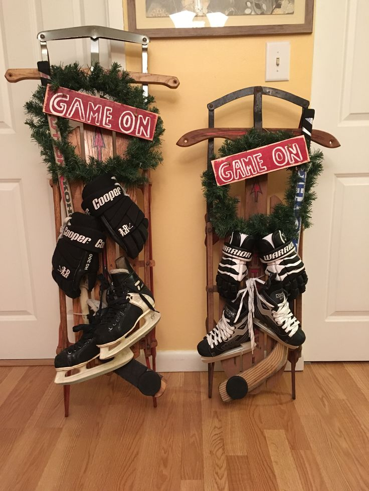 "'Vintage sleds'  decorated in a Ice Hockey Theme with stick, puck, hockey skates, hockey gloves, hand made sign, and Holiday Wreath. ""For us Many families who spend a great deal of time at Hockey Rinks  with our loved ones!!!"""