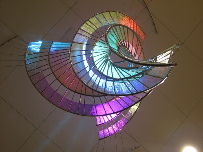 Dichroic glass and polished stainless steel sculpture at Renown Health Care Tahoe Tower lobby in Reno, NV