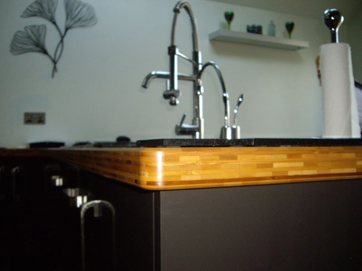 Bamboo worktop with a natural feature in the edge detailing - Real Kitchens