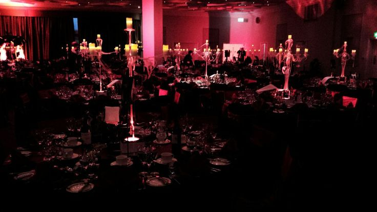 Corporate satin bows. Red satin with luxury black table cloths. #luxuryevents #corporateevents