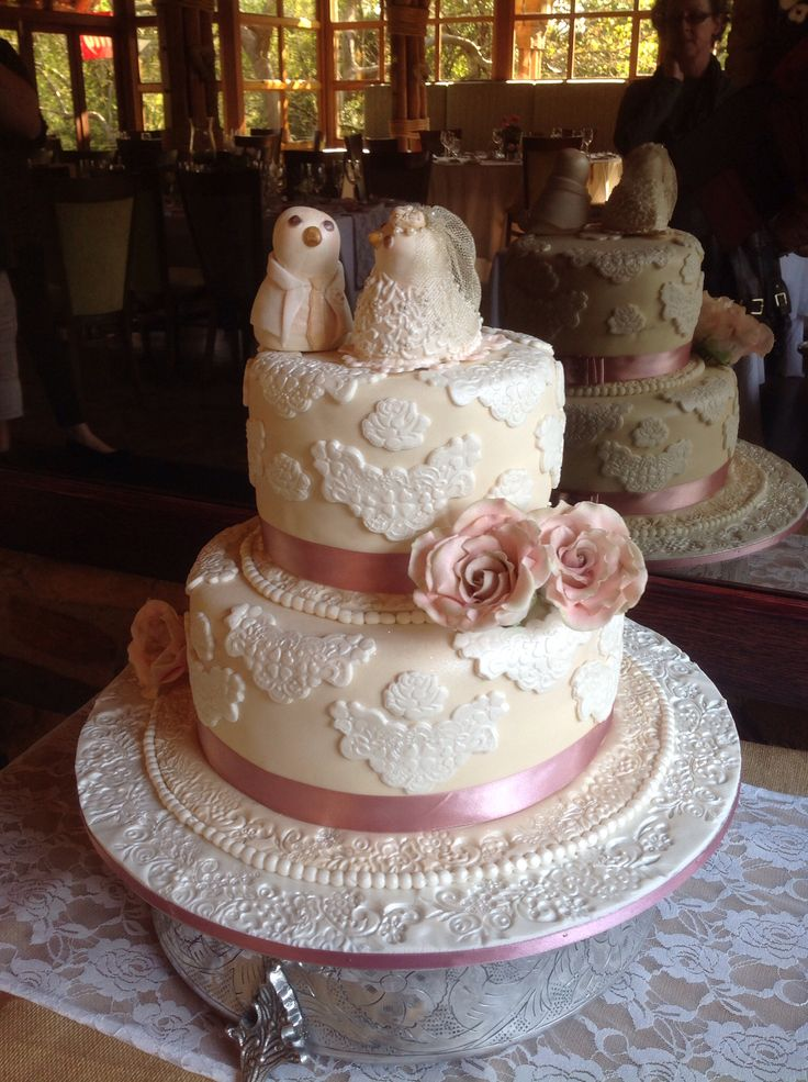 Vintage lace and rose wedding cake. Cream and white with dusky pink vintage roses. Sugar birds as toppers. By www.helens-cake-craft.co.za