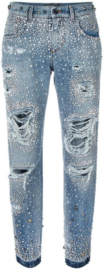 The Italian fashion house's signature luxury denim has been given a glamourous edge for Spring/Summer 2017 and these rhinestone ripped boyfriend jeans from Dolce & Gabbana are a stand-out favourite. In mid blue, comfy stretch cotton, these Dolce & Gabbana jeans feature a mid rise, a waistband with belt loops, a button and zip fly, a signature five pocket design, sparkling rhinestone embellishments, grungy, ripped details and a regular length. Dolce & Gabbana rhinestone ripped boyfriend jeans
