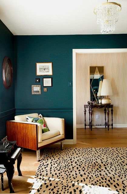 Dark color on the walls can elevate a space. This room is elegant and cozy (Paint: Benjamin Moore's Dark Harbor)