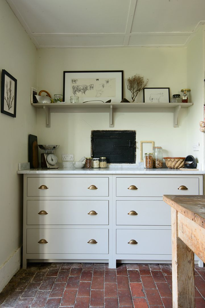 The Lidham Hill Farm Kitchen by deVOL, painted in 'Mushroom' with honed Carrara marble worktops & Bella Brass cup handles.