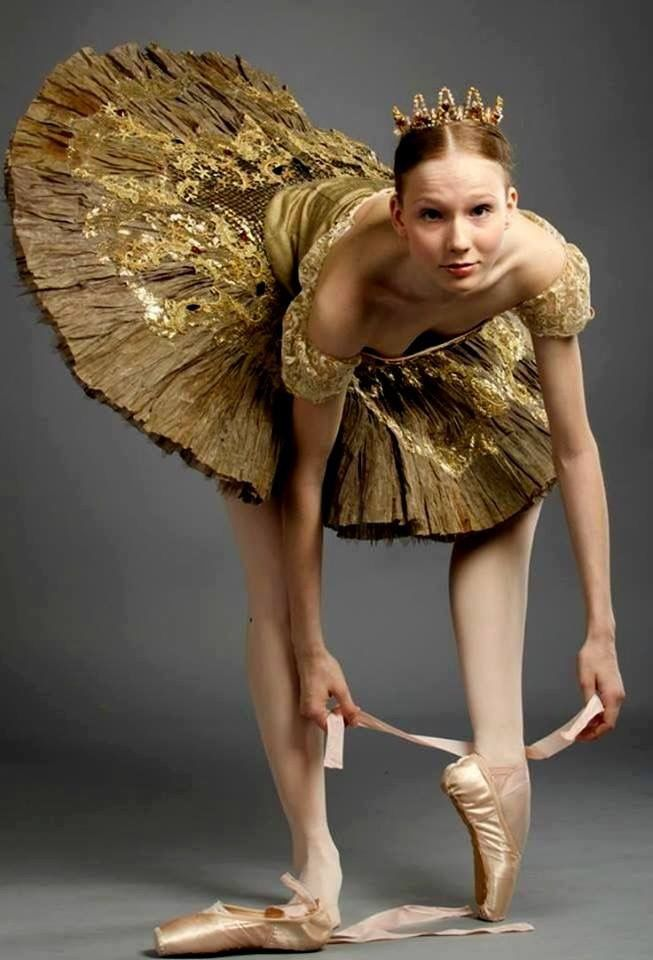 Ballerina in gold tutu