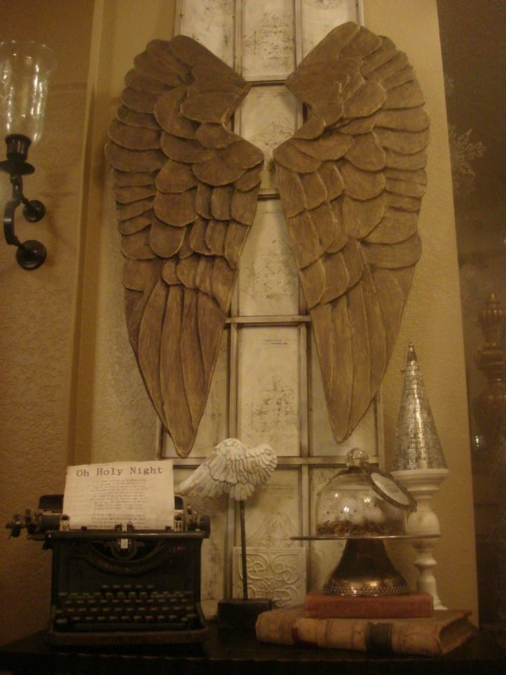 . Julie took a picture of this at the 2010 Las Vegas Market. [angel wing armoire at Belle Maison]