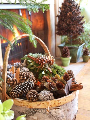 By the Basketful -- A birch bark basket gives a home cozy cabin appeal. Instead of filling the basket completely with pinecones, place an unseen filler in the basket, such as a block of florist foam or a smaller overturned container. Cover your filler with pinecones, greenery, and other natural finds.