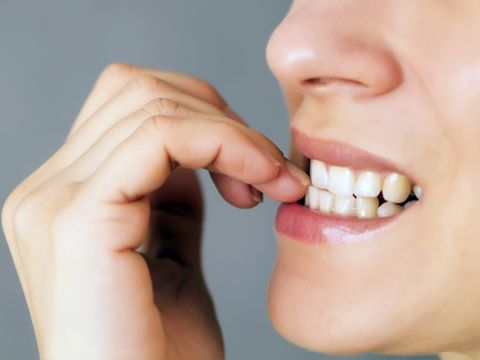 Nail biting can harm your teeth. Visit the MouthHeathy.org site to learn how to break this bad habit.