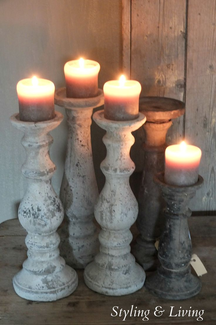 Candle holders covered in instant filler to cover up holes in the walls