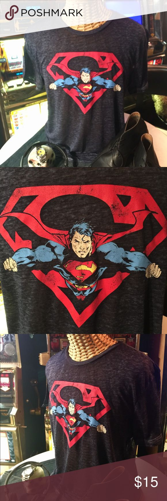 """Short sleeve burnout """"Superman"""" tee blue/black- L Short sleeve burnout tee with """"Superman"""" graphic. Note: I was unable to capture the true color of the tee which is a dark """"blue"""" black, not black as shown in the pictures. Width across the chest- 21"""". Gently pre-owned. Superman Shirts Tees - Short Sleeve"""