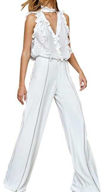 01a2eb8351d5 Free shipping and guaranteed authenticity on Alexis White Rasika Long Romper  Jumpsuit Size 8 (M)ALEXIS White romper. lace top with choker and whit.
