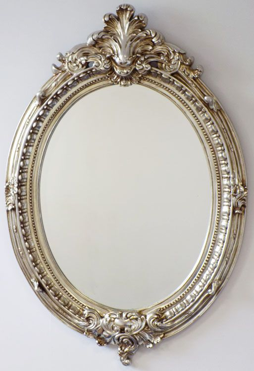 Oval antique style mirror with barque detailing and champagne finish