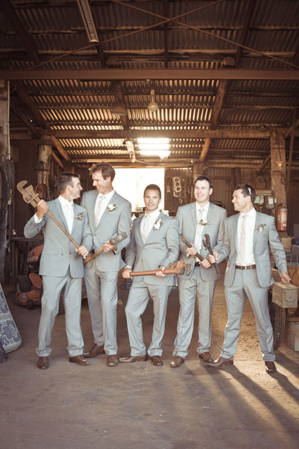 Such a fun groomsmen photo!  Work those big tools boys! Photograph by Truly Madly Photographers http://www.storyboardwedding.com/australian-country-farm-wedding-featuring-a-private-tasmania-farm-complete-with-shabby-chic-touches/