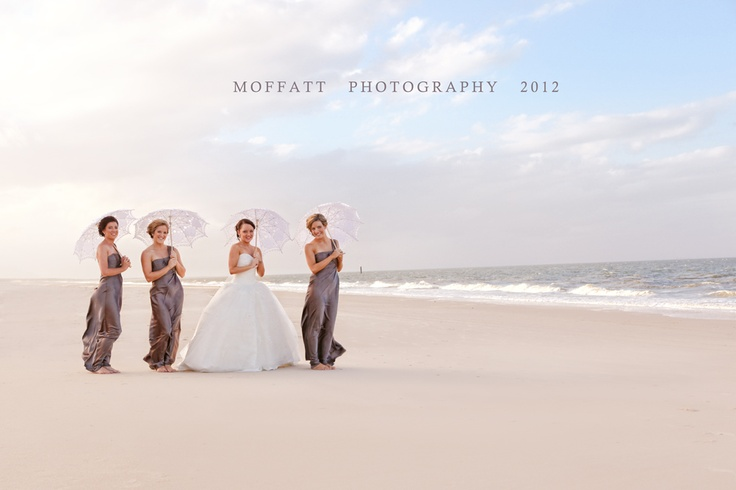 Renee and her bridesmaids at her beach wedding.