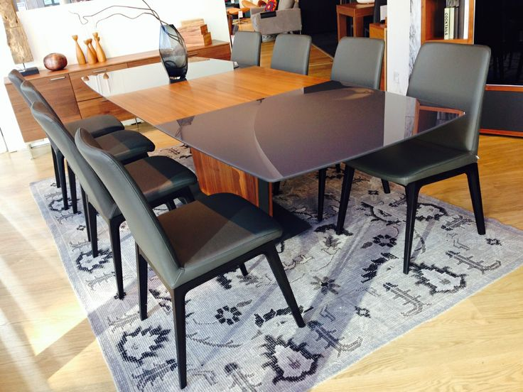 Place a rug under your dining table to add dimension and texture to your space.  #boconcept #patinarug