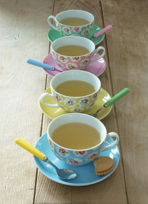 colourful vintage style teacups. this much tea & just 1 biscuit ?