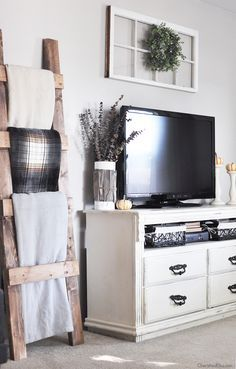 Modern Farmhouse TV Decor. Like the window, wreath, and dresser turned TV console.