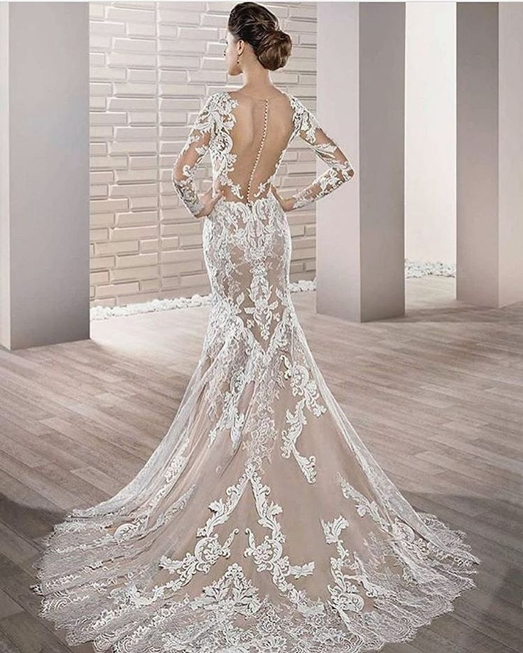 The dramatic back and sheer panels on the Azul gown by Demetrios are sure to make a lasting impression on your wedding day.  | Photography By: the Sposa Group | WedLuxe Magazine | #wedding #luxury #weddinginspiration #luxurywedding #bridal #weddinggown